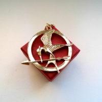 Přívěsek Hunger Games zlatá